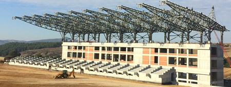"Final roof truss assembly is completed for the ""Usak University Sport Sciences Faculty and Football Field with Synthetic Track"" project."